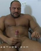 muscular guy touching dick