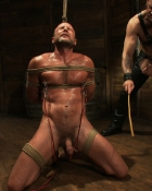 muscled gay man bound in rope