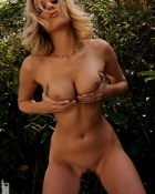 cupping her boobs with her hands