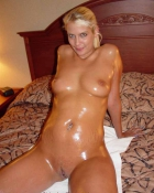 showing off oiled tits and pussy