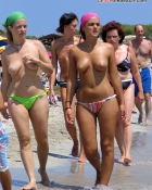 babes walking topless in the sand