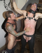 tattooed fellow stroking slaves belly