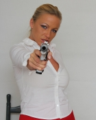 beautiful gal aiming pistol