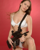 chick in lingerie with a weapon