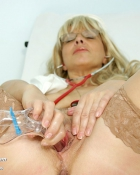 inserting instrument in her honey pot