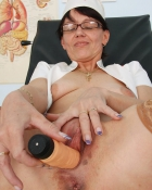 pleasuring herself with a vibrator