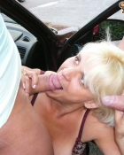 blonde sucking two cocks