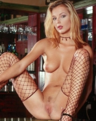 babe wearing fishnets on bar