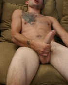 gripping his pecker