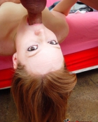 redhead enjoying a blowjob