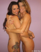 nude gals embracing each other